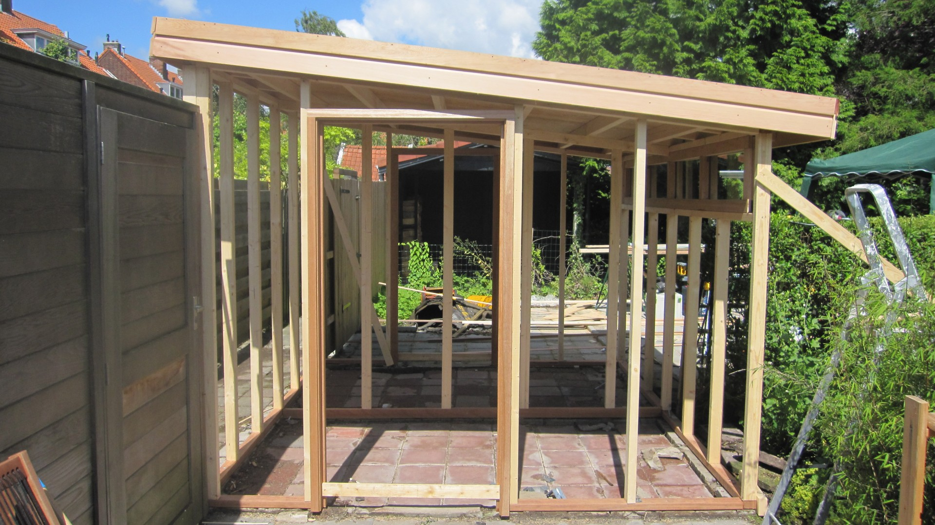 Opbouw schuur mp timmerwerken for Tuin aan laten leggen