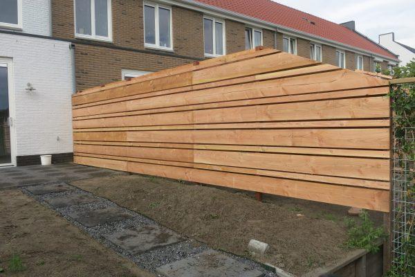 plaatsen van douglash houten schutting